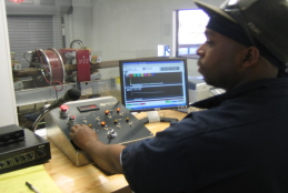 Hadco Employee Working with Electromagnetic Inspection Equipment